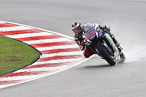 "MotoGP Breaking news Lorenzo had been ""praying for rain"" before Sepang race"