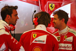 Jean-Eric Vergne, Ferrari Test and Development Driver, and Sebastian Vettel, Ferrari