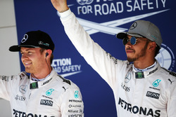 Pole sitter Lewis Hamilton, Mercedes AMG F1 (Right) celebrates his pole position with second placed team mate Nico Rosberg, Mercedes AMG F1