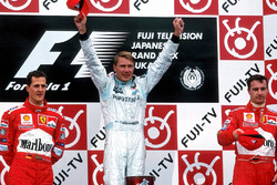 Podium: race winner and World Champion Mika Hakkinen, McLaren Mercedes, second place Michael Schumacher, Ferrari, third place Eddie Irvine, Ferrari