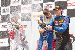 GT Cup podium: second place Alec Udell, race winner Sloan Urry, third place Corey Fergus