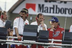 Ayrton Senna, McLaren MP4/4 Honda, DQ, on the pit gantry with Gordon Murray