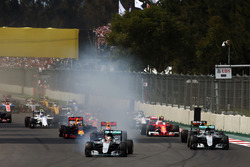 Lewis Hamilton, Mercedes AMG F1 W07 Hybrid locks up under braking as he leads at the start of the race