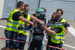 Race winner #911 Precote Herberth Motorsport Porsche 991 GT3 R: Daniel Allemann celebrates in parc ferme with his team