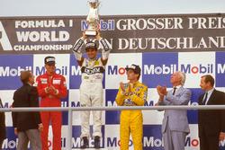 Podium: race winner Nelson Piquet, Williams, second palce Stefan Johansson, McLaren, third place Ayrton Senna, Team Lotus