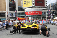 IMSA Photos - Corvette Racing demonstrates a pit stop in downtown Toronto