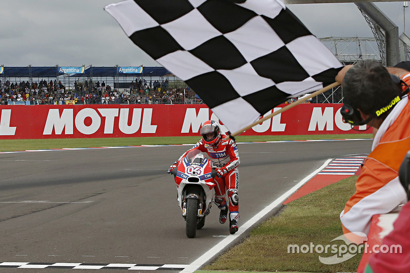 Andrea Dovizioso, Ducati Team pushes his bike across the line