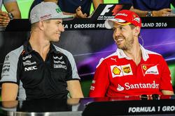 Nico Hulkenberg, Sahara Force India F1 with Sebastian Vettel, Ferrari in the FIA Press Conference