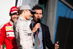 Podium: winner Nico Rosberg, Mercedes AMG F1 Team, third place Sebastian Vettel, Ferrari with Mark Webber, Porsche Team WEC Driver and Channel 4 Presenter