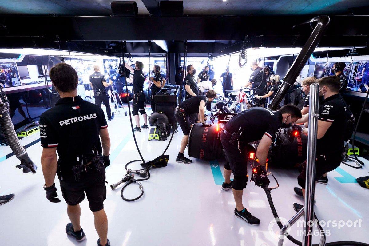 Mechanics at work in the Mercedes garage