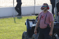 Tony Stewart watches the practice from the infield