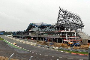 Absent Ecclestone aims jibe at Silverstone delay
