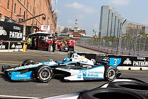 Penske's Castroneves keep his lead in the championship on a wild race at Baltimore