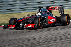 McLaren drivers on their final race of 2013 at Brazil