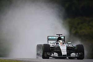 Rainy qualifying in Sepang with Hamilton in pole and Rosberg in third