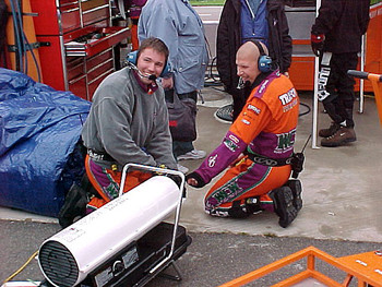 Crew warming hands with heater