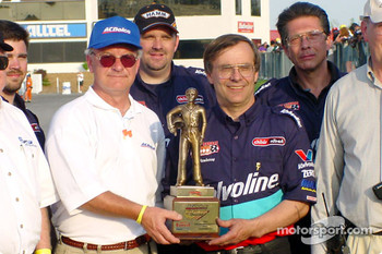 Bob Newberry accepts his second trophy at VMP. His first was when NHRA sponsored the drag racing at VMP