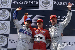 The podium: Juan Pablo Montoya, Michael Schumacher and David Coulthard