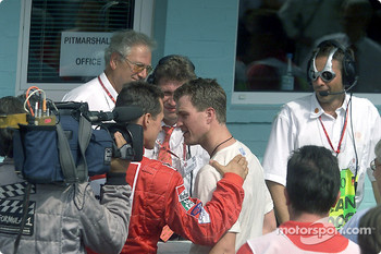 Michael Schumacher congratulating brother Ralf