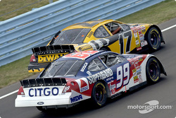 Jeff Burton overtakes teammate Matt Kenseth on his way to a second place finish