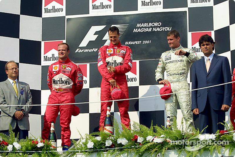 The podium: Rubens Barrichello, Michael Schumacher and David Coulthard