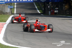Rubens Barrichello in front of Michael Schumacher