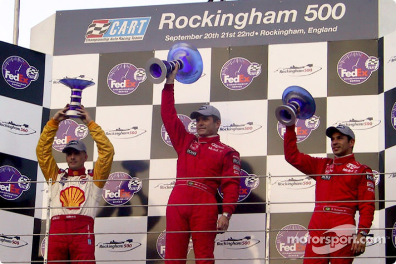 The podium: race winner Gil de Ferran, with Kenny Brack and Helio Castroneves
