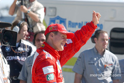 On the grid: Michael Schumacher waiving