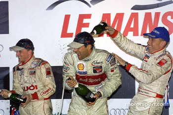 LMP900 podium: champagne for Johnny Herbert, Emanuele Pirro and Andy Wallace