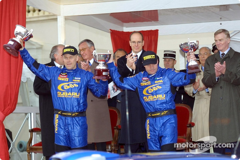 The podium: Tommi Makinen and co-driver Kaj Lindstrom celebrating with Prince Albert and Max Mosley