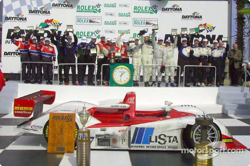 The Class winners display their new Rolex watches in Victory Lane
