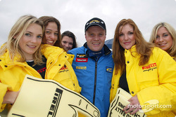 Tommi Makinen with the Pirelli girls