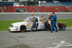 Jerry Hill helps his crew push his race truck onto pit lane