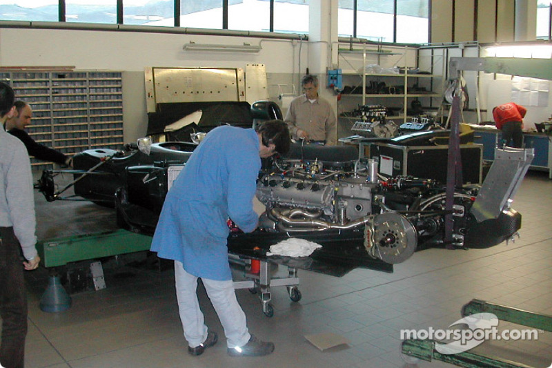 Technicians attach the headers to the Infiniti Q45 engine