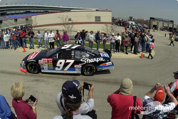 Kurt Busch in his Rubbermaid / Sharpie Ford winding through the crowd for morning practice