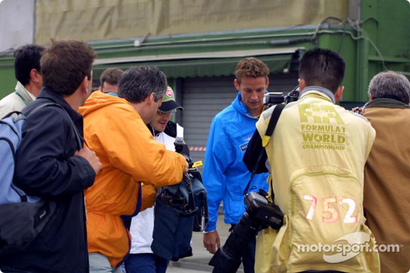 Jacques Villeneuve and Jenson Button arriving in the paddock
