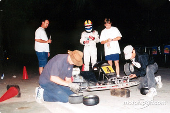 Endurance Karts require tire changes too; Wayne Taylor over sees the Team Cadillac tire stop; the swap took 4 minutes and 20 seconds, and Warren Scheckter was back in the chase