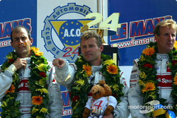 The overall and LMP 900 - LM GTP podium: race winners Emanuele Pirro, Tom Kristensen and Frank Biela