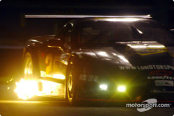 The AGT-winning #25 Corvette of LG Motorsports spits fire as it turns through Daytona's infield