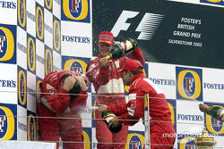 Champagne for Michael Schumacher, Rubens Barrichello and Ross Brawn