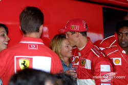 Michael Schumacher and wife Corina celebrating