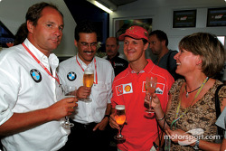 BMW Motorsport Director Mario Theissen celebrating his 50th birthday with friends: Gerhard Berger, Mario Theissen and Michael Schumacher
