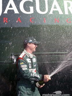 Eddie Irvine celebrates podium finish
