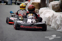 Milford natives #38-Matt Jester and #28-Jason Lavere battle down Pearl Alley during the Rodney J. Harrington Memorial Pro Race