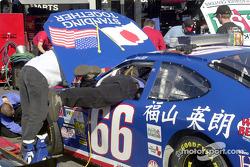 A crewman diving into Hideo Fukuyama's car