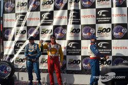 The podium: champagne for Jimmy Vasser, Patrick Carpentier and Michael Andretti