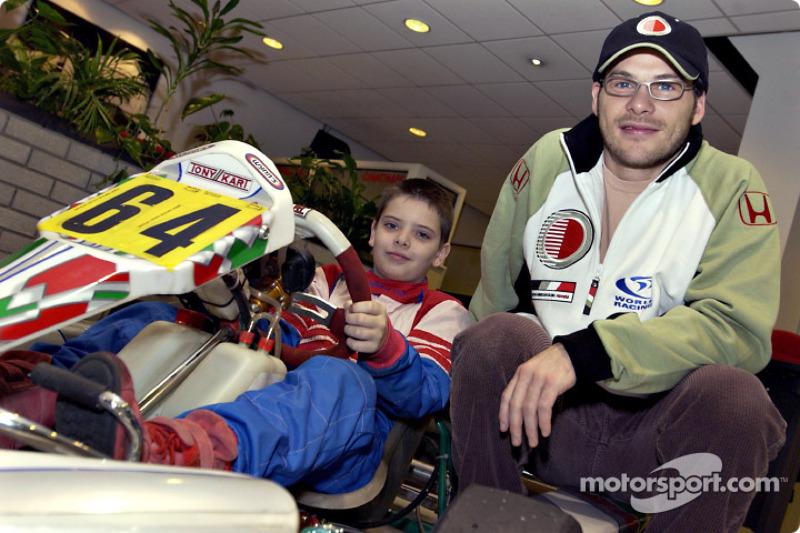 Jacques Villeneuve with a young kart racer