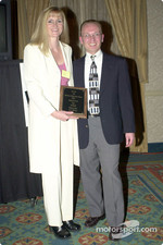Kim Hart display's her broadcast award with Earl Krause of Area Auto Racing News