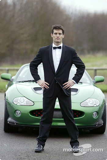 Mark Webber poses with the James Bond 007 XK-R during a photoshoot at the Jaguar Racing headquarters in Milton Keynes