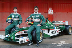 Mark Webber and Antonio Pizzonia pose with the new Jaguar R4